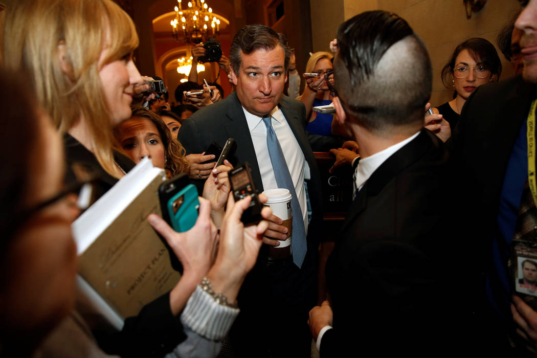 U.S. Senator Ted Cruz, R-Texas, is surrounded by reporters as he arrives for a meeting of the Senate Republican caucus at the U.S. Capitol in Washington, July 13, 2017. (Jonathan Ernst/Reuters)