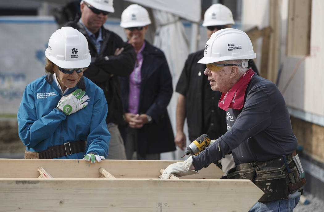 Former President Jimmy Carter and his wife Rosalynn help build homes for Habitat for Humanity in Edmonton Alberta, Tuesday, July 11, 2017. (Jason Franson/The Canadian Press via AP)