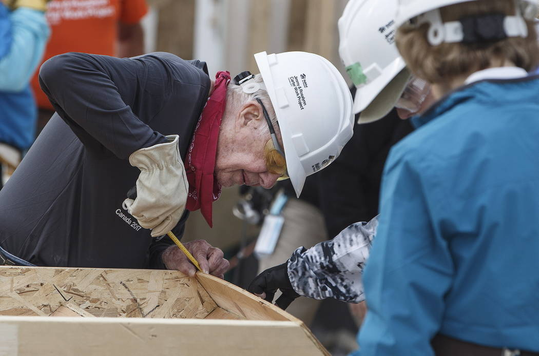 Former President Jimmy Carter helps build homes for Habitat for Humanity in Edmonton Alberta, Tuesday, July 11, 2017. (Jason Franson/The Canadian Press via AP)