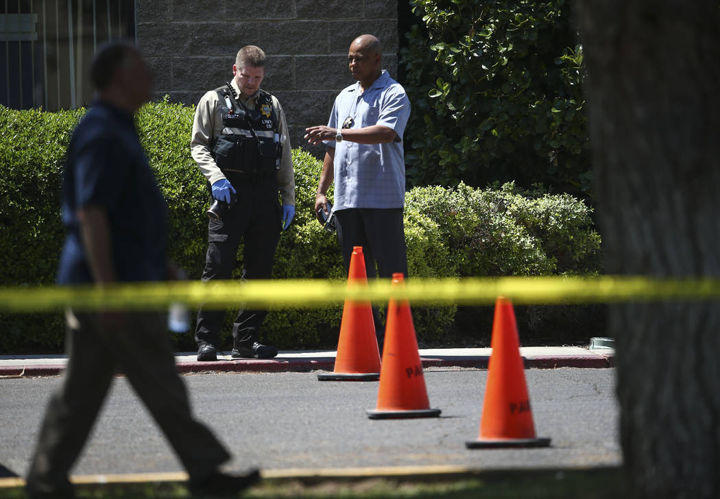 UNLV police investigate the scene where gunshots were fired at a parked truck from a car on the UNLV campus in Las Vegas on Thursday, July 13, 2017. Chase Stevens Las Vegas Review-Journal @cssteve ...