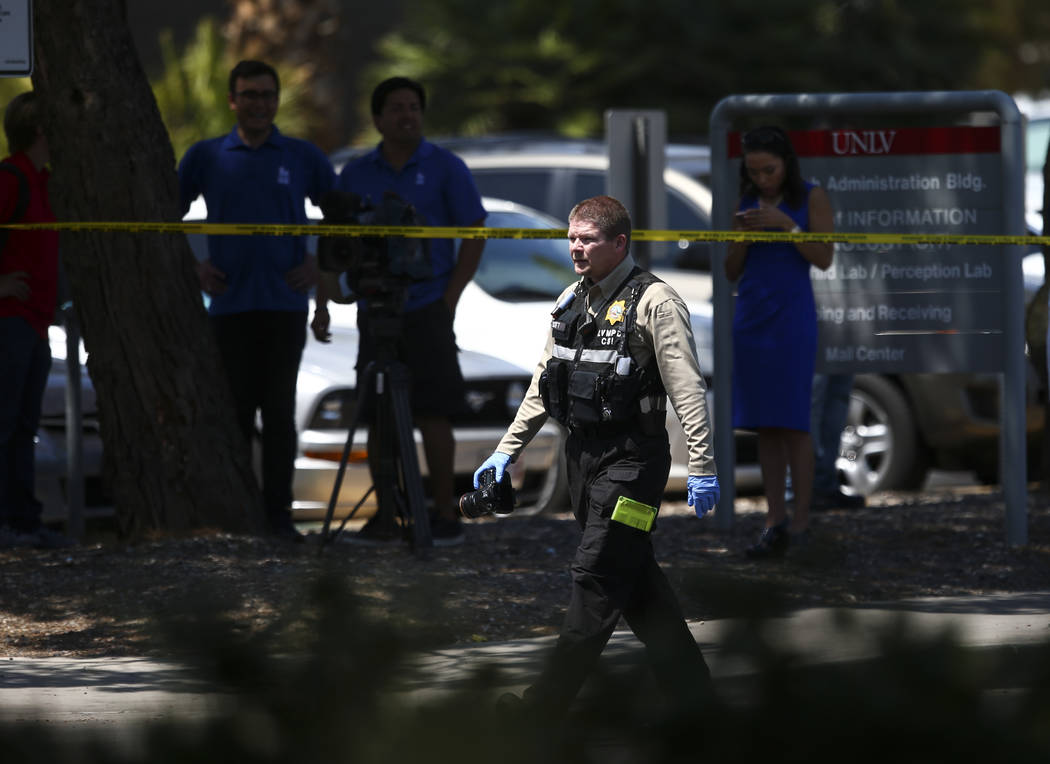 A Las Vegas police crime scene investigator at the scene where gunshots were fired at a parked truck from a car on the UNLV campus in Las Vegas on Thursday, July 13, 2017. Chase Stevens Las Vegas  ...