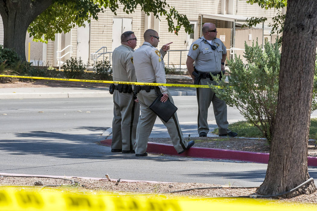 Metropolitan Police congregate after a woman and her 11-year-old daughter were shot at inside their white Ford pickup truck on the campus of UNLV on Thursday, July 13, 2017.  Patrick Connolly Las  ...