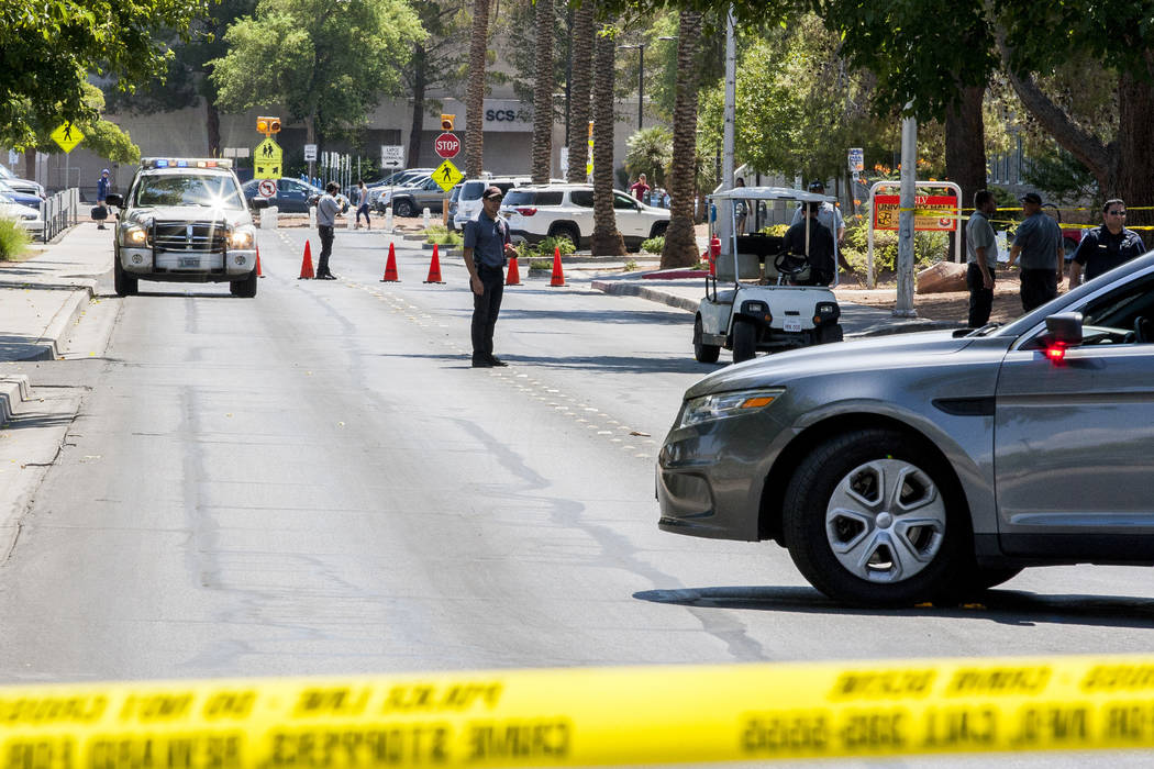 The crime scene after a woman and her 11-year-old daughter were shot at inside their white Ford pickup truck on the campus of UNLV on Thursday, July 13, 2017.  Patrick Connolly Las Vegas Review-Jo ...