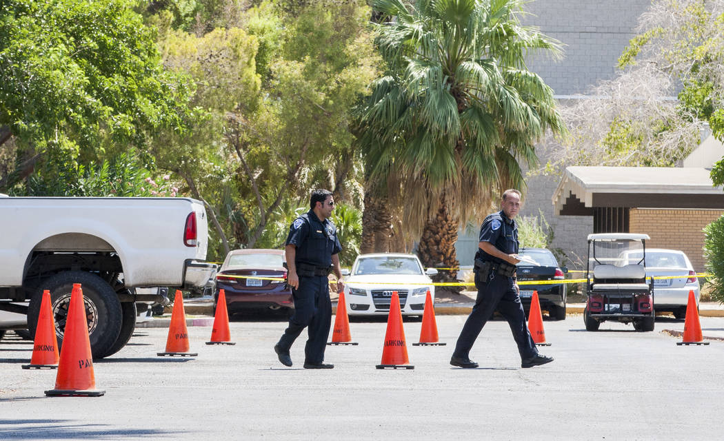UNLV police walk around the crime scene after a woman and her 11-year-old daughter were shot at inside their white Ford pickup truck on the campus of UNLV on Thursday, July 13, 2017.  Patrick Conn ...