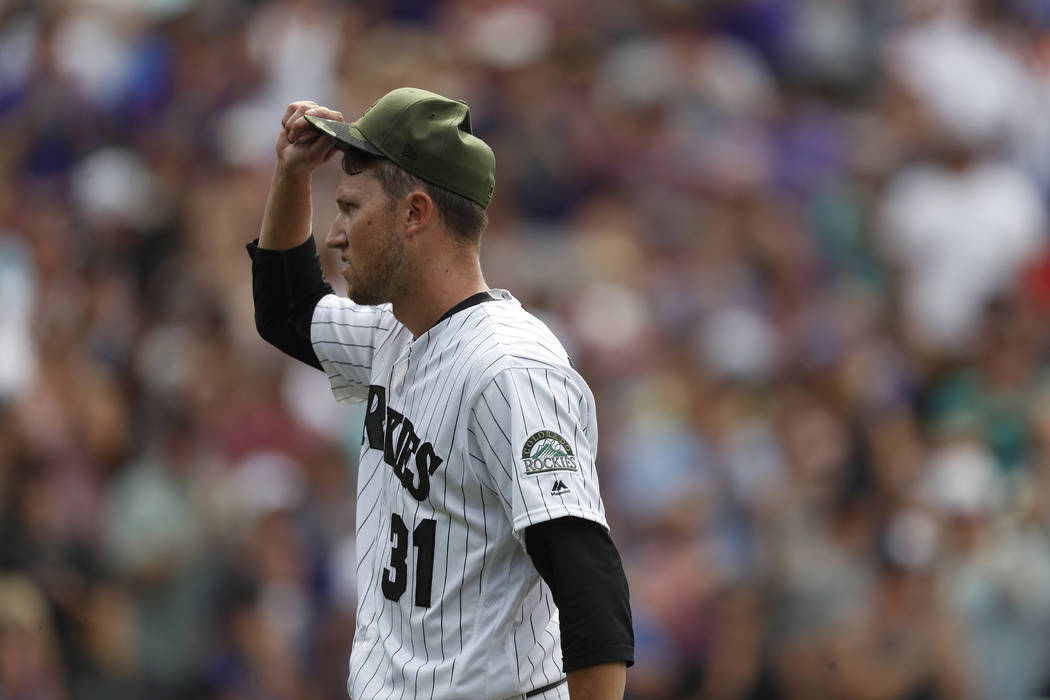Colorado Rockies starting pitcher Kyle Freeland (31) tips his cap after his no-hit bid was broken up by Chicago White Sox left fielder Melky Cabrera (53) in the ninth inning of a baseball game Sun ...