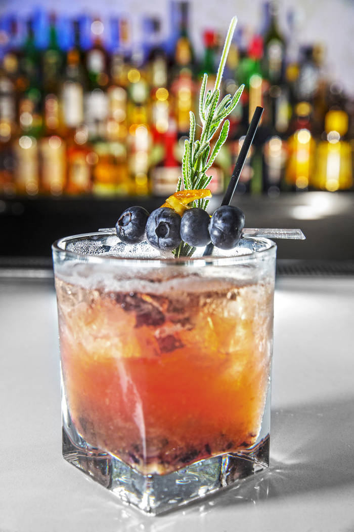 The Bee's Bullocks, with Earl Grey and lavender infused gin, Pavan, St. Germaine, simple syrup, lemon, honey and muddled blueberries at Infusion Lounge on Friday, July 21, 2017, at The Linq hotel- ...