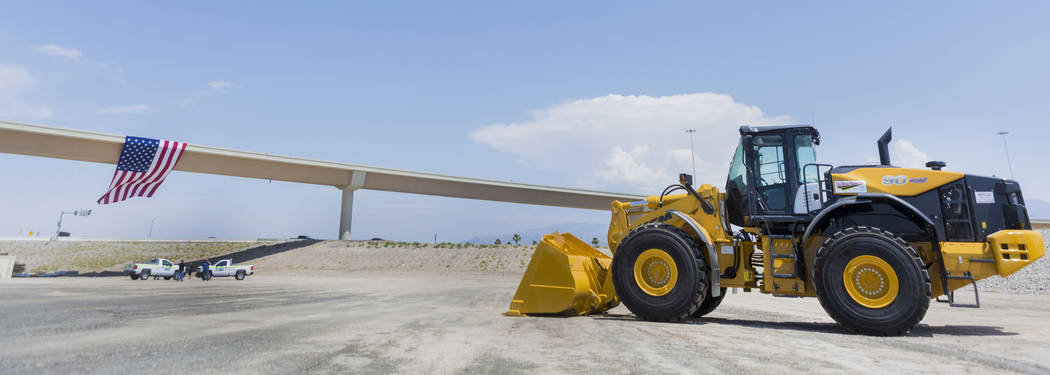 """The Centennial Bowl,"" a 60-foot-tall, half-mile long flyover bridge linking westbound 215 Beltway and the southbound U.S. Highway 95 opens in northwest Las Vegas, Wednesday, Jul ..."