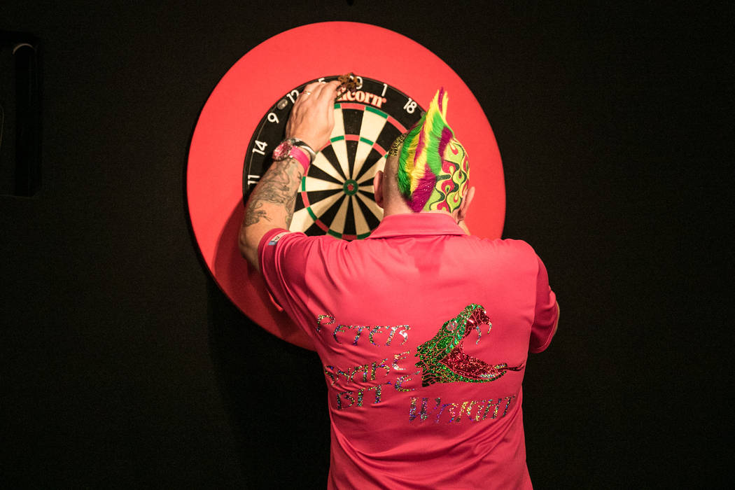 Peter Wright taking out his darts at the PDC's World Series of Darts Festival at Tropicana hotel-casino on Friday, July 14, 2017, in Las Vegas. Morgan Lieberman Las Vegas Review-Journal