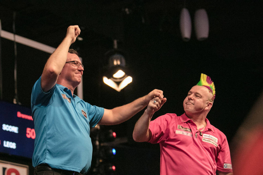 Peter Wright and Shawn Brenneman show support towards each other at the PDC's World Series of Darts Festival at Tropicana hotel-casino on Friday, July 14, 2017, in Las Vegas. Morgan Lieberman Las  ...