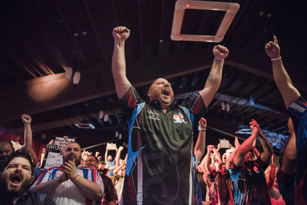 Minnesota resident Jon Ulness shows his support for the last few minutes of the match at the PDC's World Series of Darts Festival at Tropicana hotel-casino on Friday, July 14, 2017, in Las Vegas.  ...