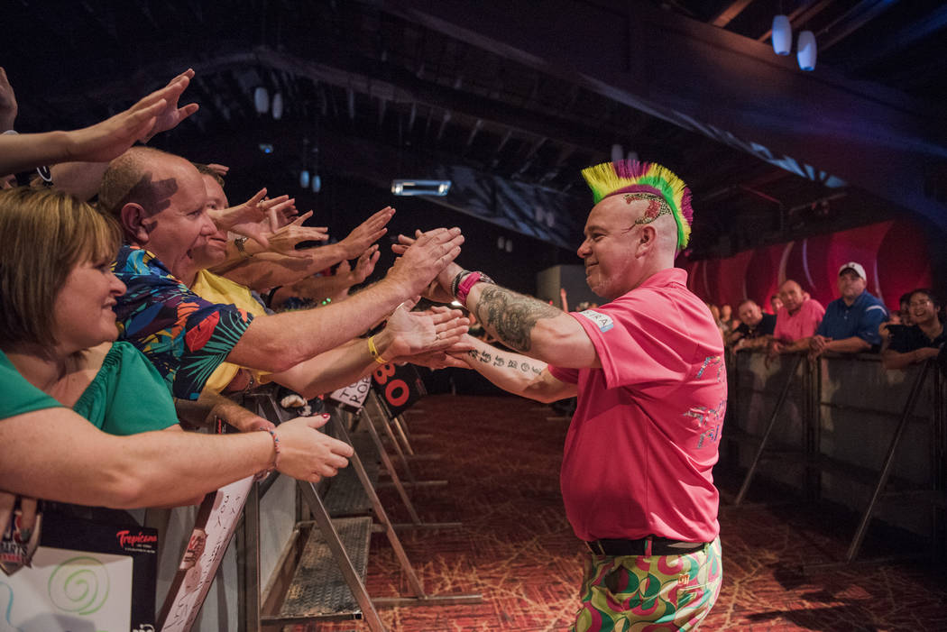 Peter Wright embraces fans after his winning match at the PDC's World Series of Darts Festival at Tropicana hotel-casino on Friday, July 14, 2017, in Las Vegas. Morgan Lieberman Las Vegas Review-J ...