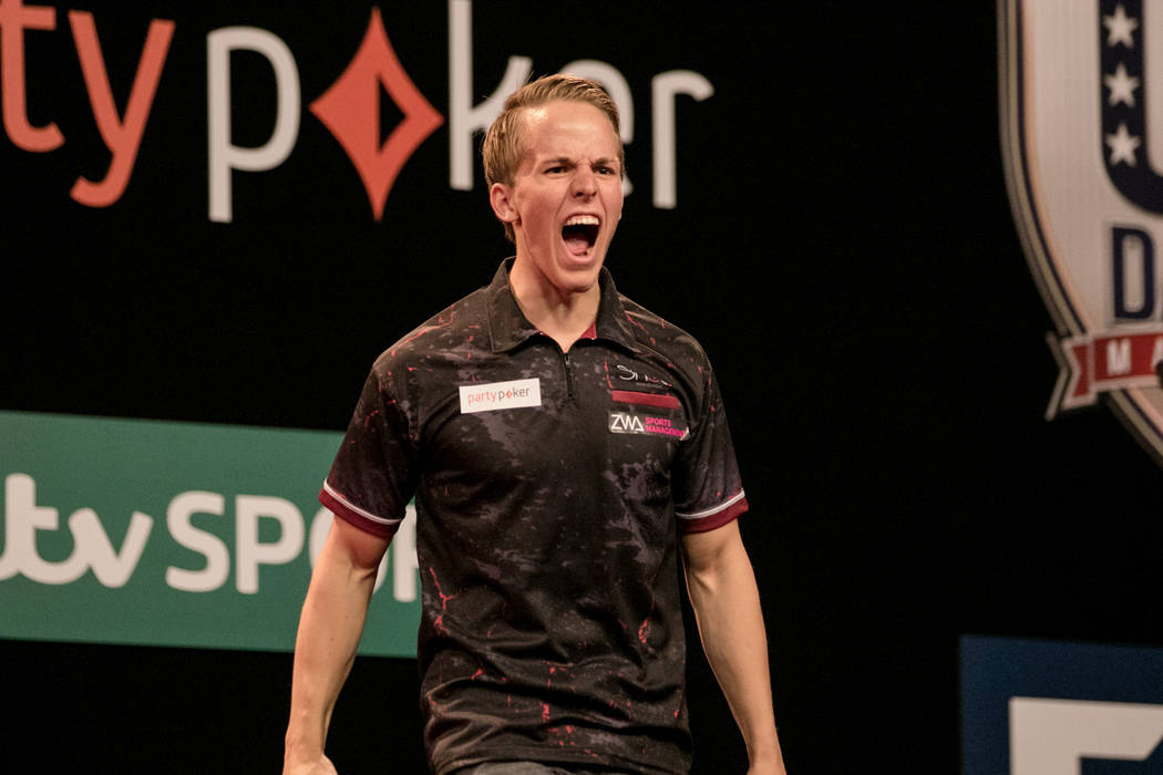 Dawson Murschell shows excitement for his winning score in the fourth leg of the match at the PDC's World Series of Darts Festival at Tropicana hotel-casino on Friday, July 14, 2017, in Las Vegas. ...