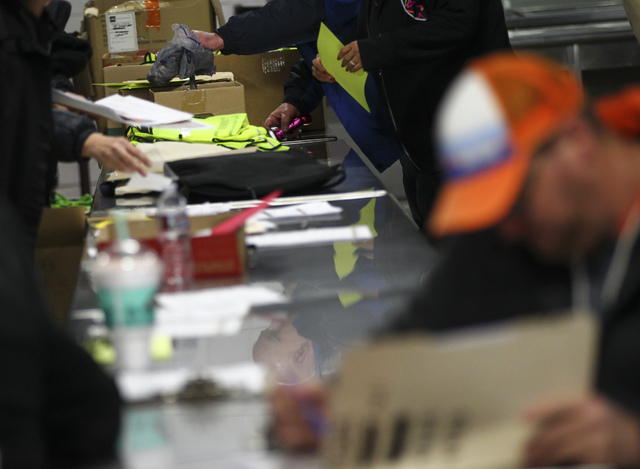Volunteers prepare before the start of the Southern Nevada Homeless Census at Catholic Charities in downtown Las Vegas on Tuesday, Jan. 24, 2017. (Chase Stevens/Las Vegas Review-Journal) @cssteven ...
