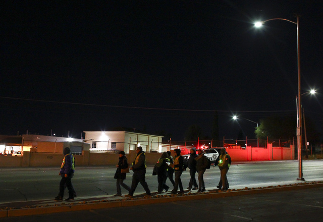Volunteers and Las Vegas police search for homeless people along Main Street during the Southern Nevada Homeless Census in downtown Las Vegas on Tuesday, Jan. 24, 2017. (Chase Stevens/Las Vegas Re ...