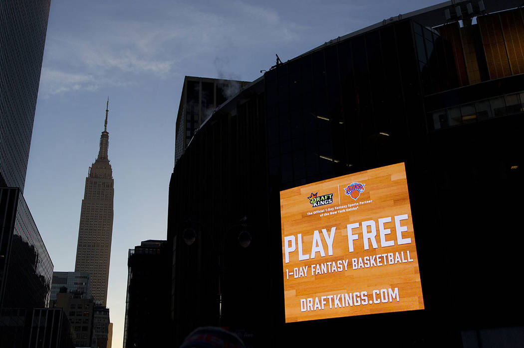 An electronic advertisement for DraftKings hangs on the side of Madison Square Garden in New York in 2016. (AP Photo/Mark Lennihan, File)