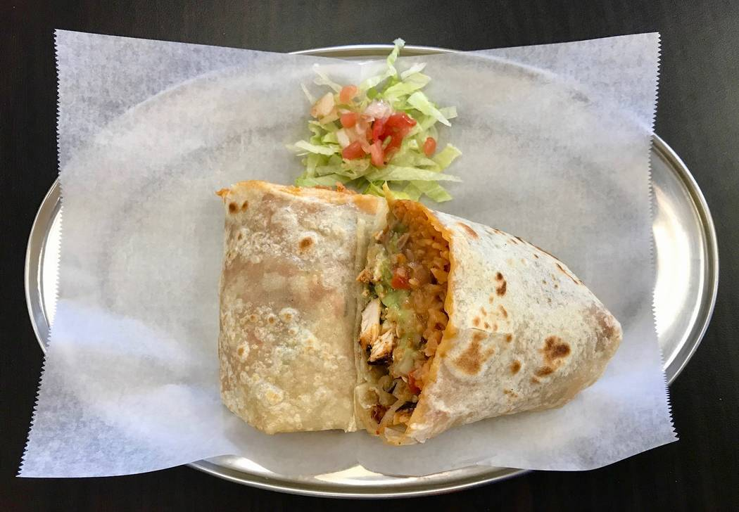 The chicken burrito with rice, beans, guacamole and pico de gallo ($7.99). (Madelyn Reese/View) @MadelynGReese