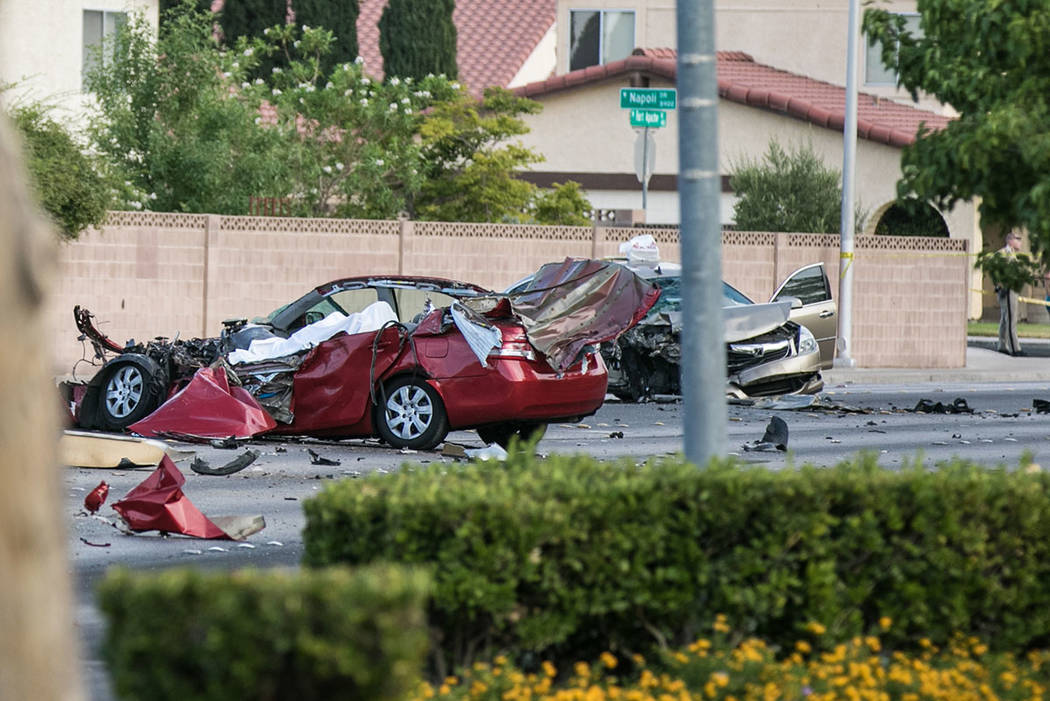 Police investigate a multivehicle crash near Charleston Boulevard and Fort Apache Road in Las Vegas, Wednesday, July 5, 2017. (Morgan Lieberman Las Vegas Review-Journal)