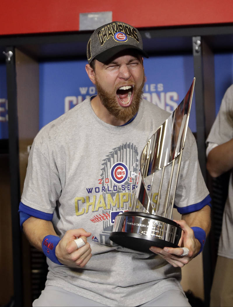 Chicago Cubs' Ben Zobrist celebrates with his MVP trophy after Game 7 of the Major League Baseball World Series against the Cleveland Indians Thursday, Nov. 3, 2016, in Cleveland. The Cubs won 8-7 ...