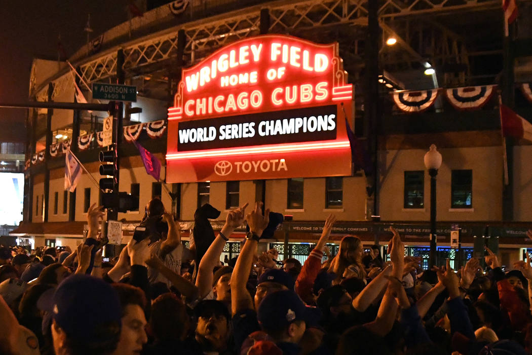 Chicago Cubs fans celebrate after game seven of the 2016 World Series against the Cleveland Indians outside of Wrigley Field in 2016. (Patrick Gorski-USA TODAY Sports)