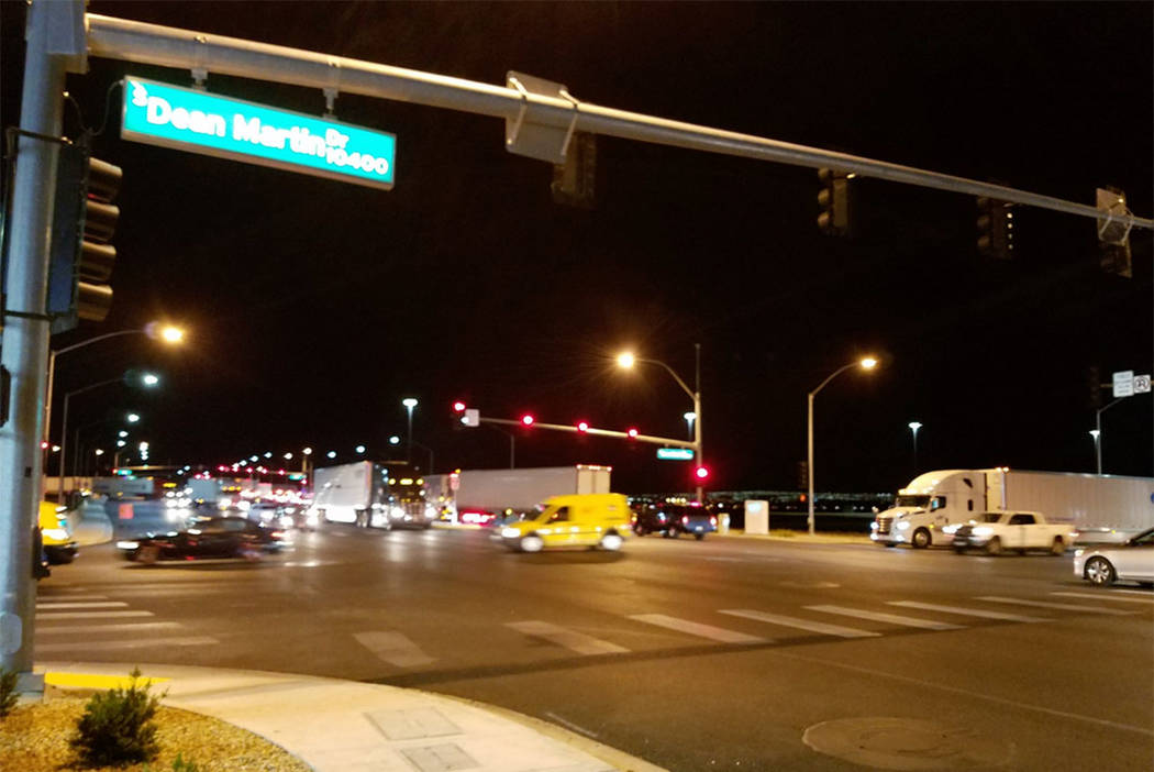 Vehicles move through an intersection near Interstate 15 during a barricade situation that closed the interstate Thursday night. (Mike Shoro/Las Vegas Review-journal)