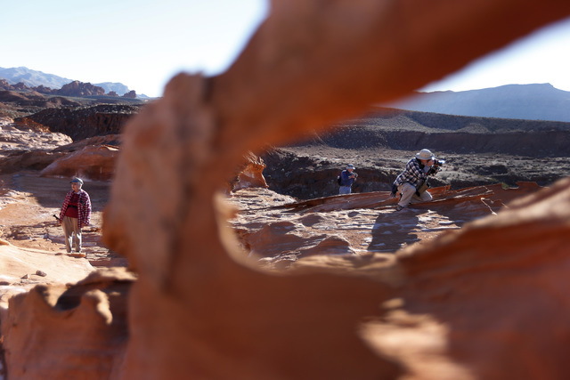 Visitors look at the view and take photos at at Gold Butte National Monument on Tuesday, Jan. 17, 2017, in Gold Butte, Nevada. (Christian K. Lee/Las Vegas Review-Journal) @chrisklee_jpeg
