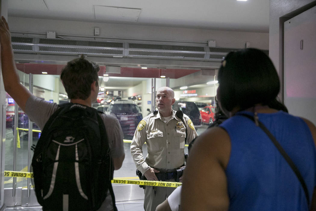 People try to get to their cars near the entrance of the parking garage near the Miracle Mile Shops at The Strip in  Las Vegas, Thursday, July 13, 2017. Fox was found guilty for attempted murder,  ...