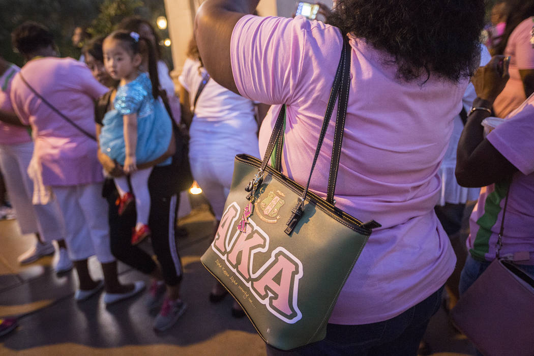 Members of Alpha Kappa Alpha Sorority gather as they wait at the Bellagio Fountains for their leadership conference's opening ceremony on Thursday, July 13, 2017, in Las Vegas. The fountains were  ...