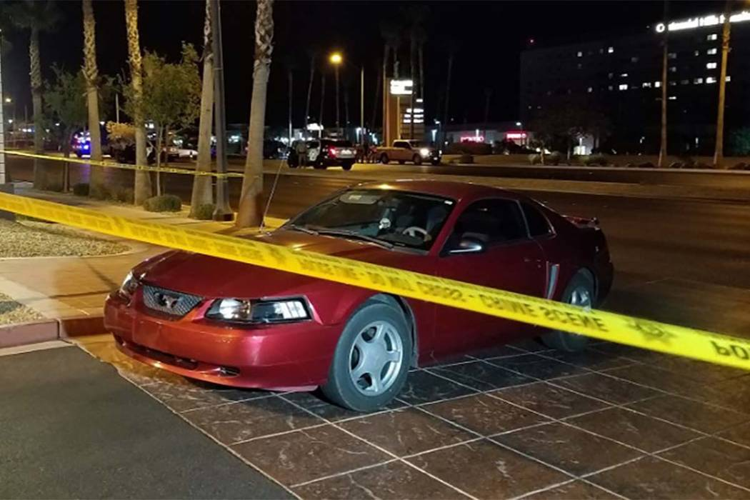 The driver of a red sedan immediately pulled over after hitting a pedestrian and tried to help her, according to police. (Mike Shoro/Las Vegas Review-Journal)