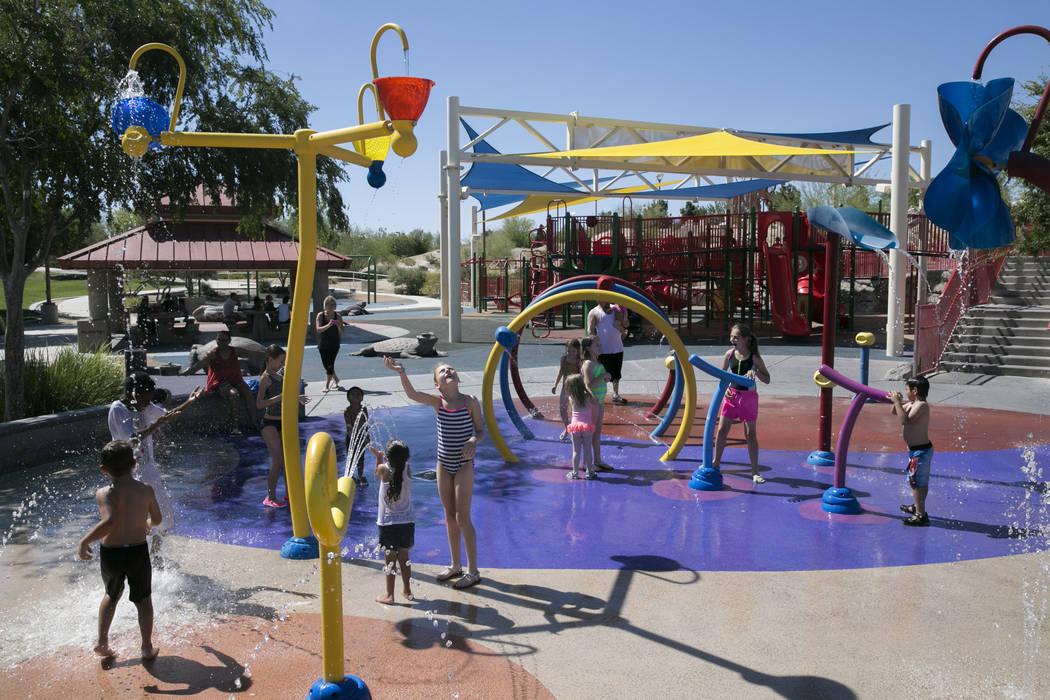 Kids play at the waterpark in Centennial Hills Park in northwest Las Vegas. (Gabriella Angotti-Jones/Las Vegas Review-Journal) @gabriellaangojo