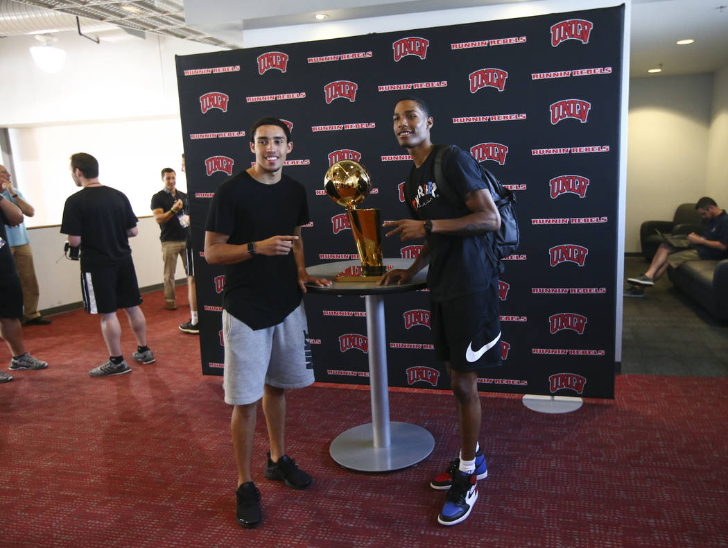 Golden State Warriors' Patrick McCaw, right, poses next to the Larry O'Brien Trophy with fellow former UNLV player Austin Starr in Mendenhall Center at UNLV in Las Vegas on Friday, July 14, 2017.  ...
