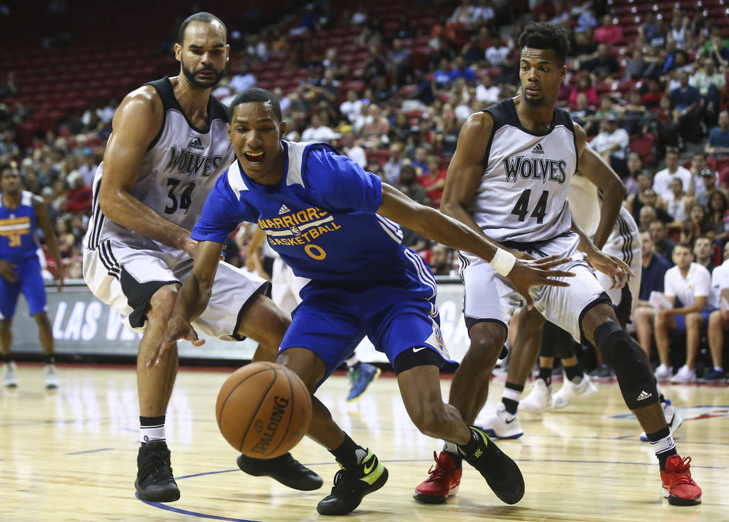 Golden State Warriors' Patrick McCaw (0) runs for the ball against Minnesota Timberwolves' Perry Ellis (34) and Charles Cooke (44) during a basketball game at the NBA Summer League at the Thomas & ...