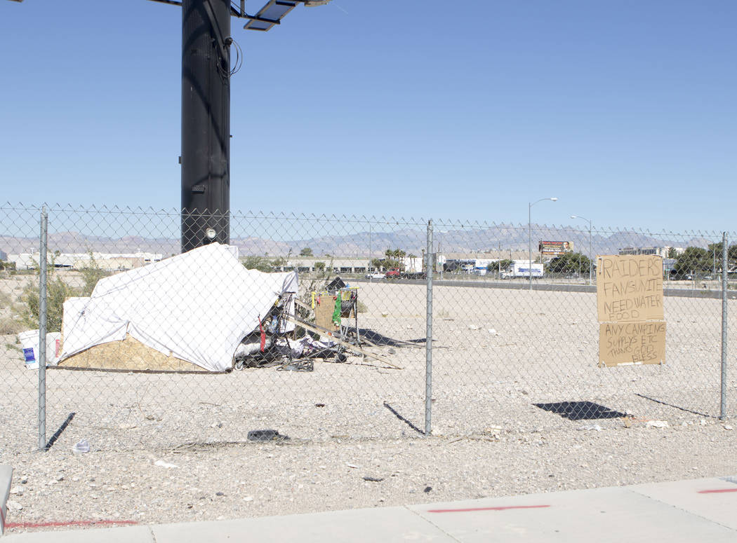 A sign near a tent facing Dean Martin Drive at the Raiders stadium site in Las Vegas asks for assistance on Friday, May 19, 2017. (Heidi Fang/Las Vegas Review-Journal) @HeidiFang