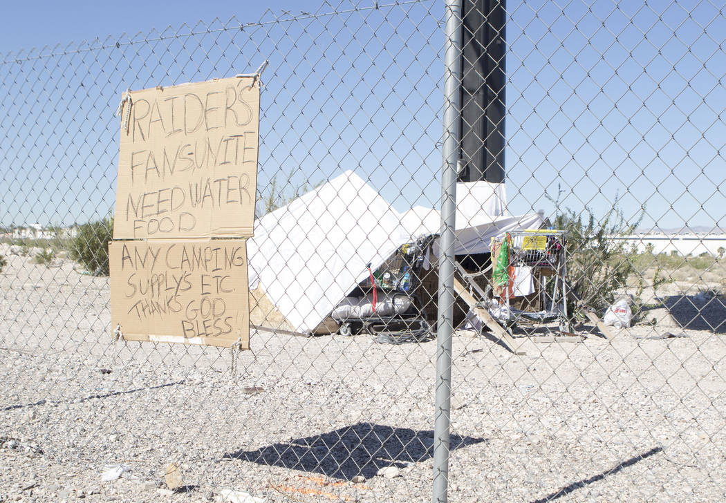 A sign is posted near Dean Martin Drive on the fence of the Raiders stadium site in Las Vegas on Friday, May 19, 2017. (Heidi Fang/Las Vegas Review-Journal) @HeidiFang