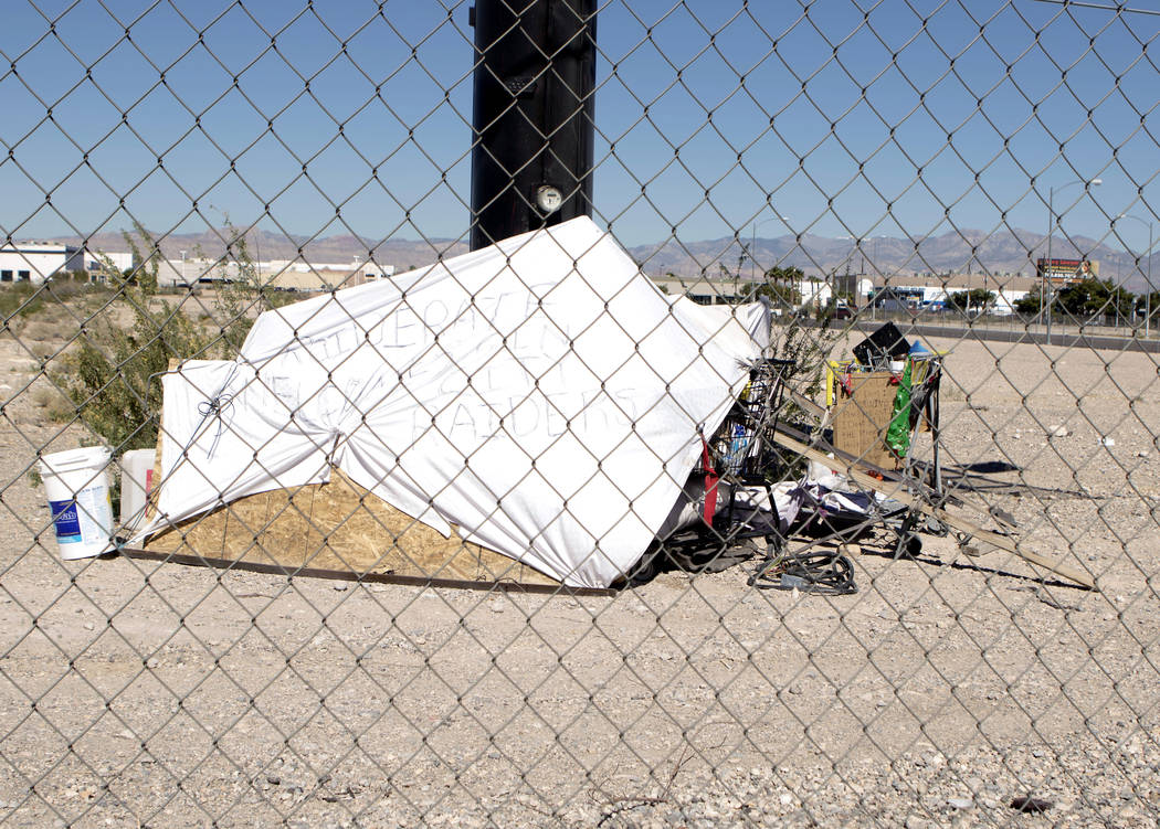 """""""Raiderate welcomes Sin City Raiders"""" is written on a sheet covering a structure near Dean Martin Drive and Connector Road at the Raiders stadium site in Las Vegas on Friday, May 19, 2017. (Heidi  ..."""