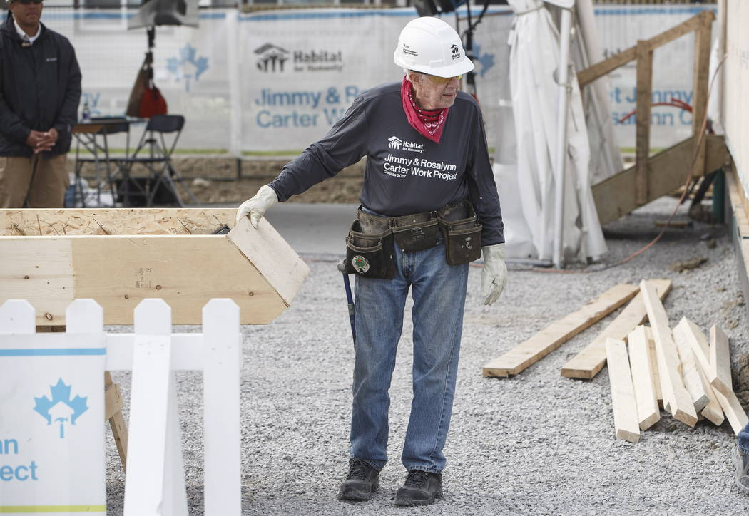 Former President Jimmy Carter helps build homes for Habitat for Humanity in Edmonton Alberta on Tuesday, July 11, 2017. (Jason Franson/The Canadian Press via AP)
