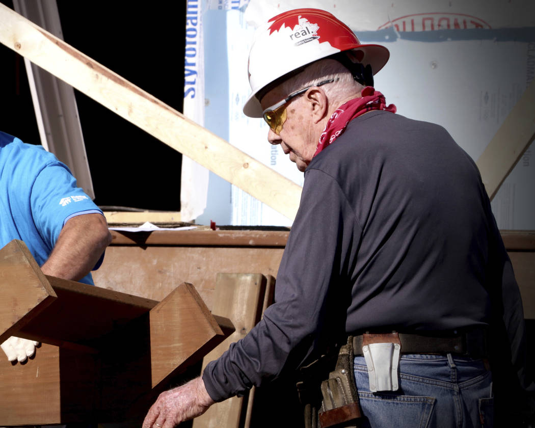 Former U.S. President Jimmy Carter helps build homes for Habitat for Humanity in Winnipeg, Manitoba on Thursday, July 13, 2017. Carter was treated for dehydration while volunteering with Habitat f ...