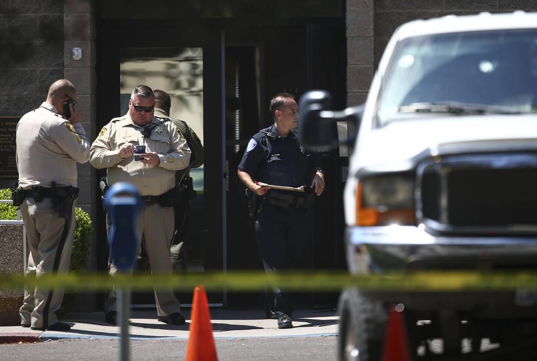 UNLV police investigate the scene where gunshots were fired at a parked truck, right, from a car on the UNLV campus in Las Vegas on Thursday, July 13, 2017. (Chase Stevens/Las Vegas Review-Journal ...