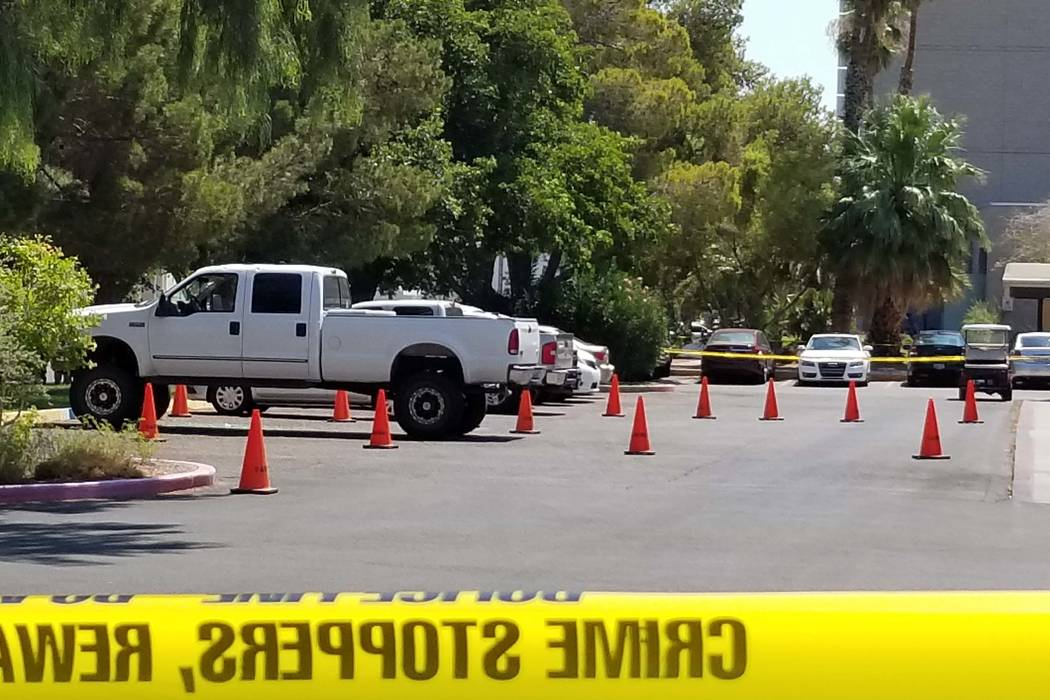 UNLV officials investigate after someone is a car shot at a pickup truck near the public safety building, Thursday, July 13, 2017. (Patrick Connolly/Las Vegas Review-Journal)