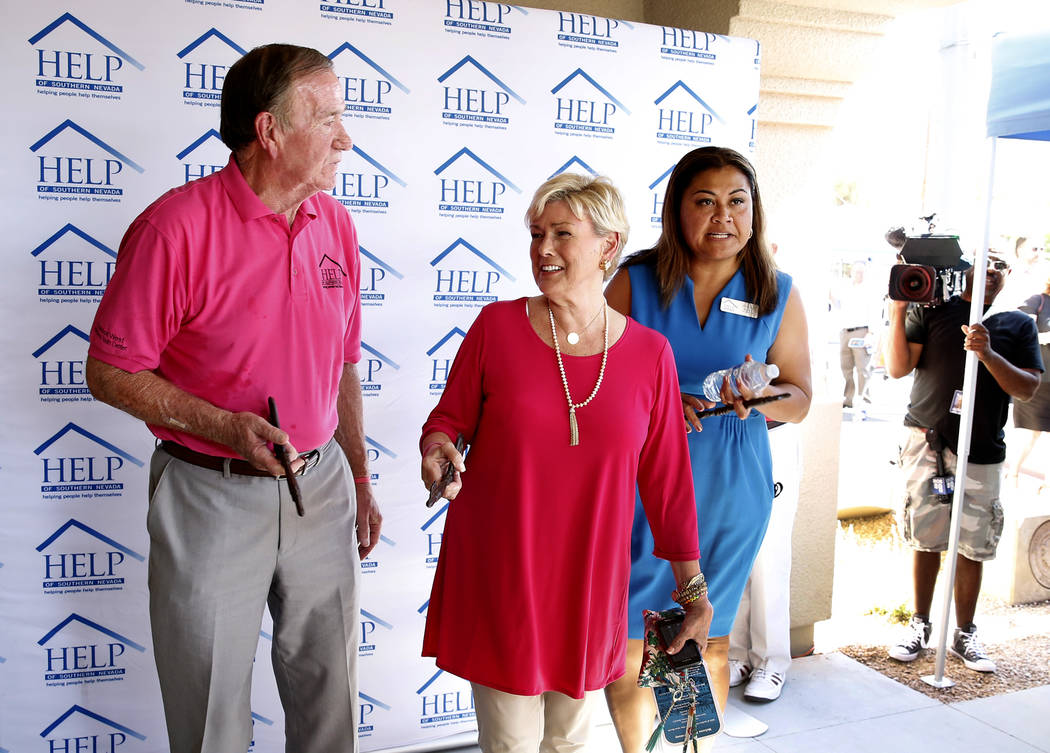 Tom West and his wife, Susan, center, parents of Shannon West, and Fuilala Riley, president and CEO HELP of Southern Nevada, prepare to open the new Shannon West Homeless Youth Center on 1650 E. F ...
