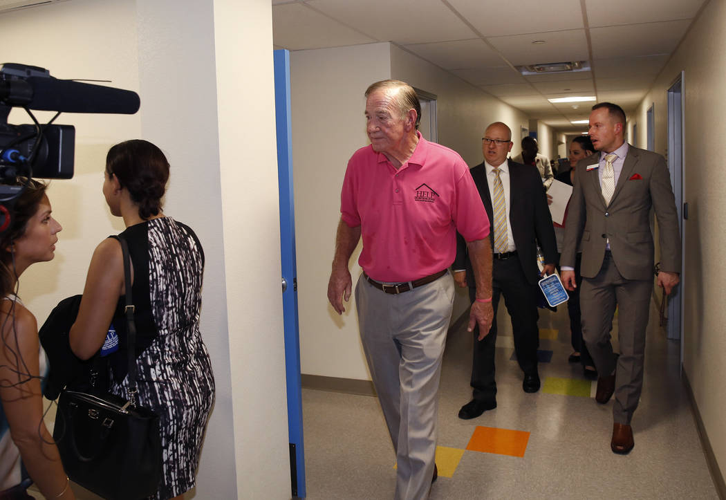 Tom West, left, father of Shannon West, tours the new Shannon West Homeless Youth Center during the grand opening ceremony of the center on 1650 E. Flamingo Road, on Friday, July 14, 2017, in Las  ...
