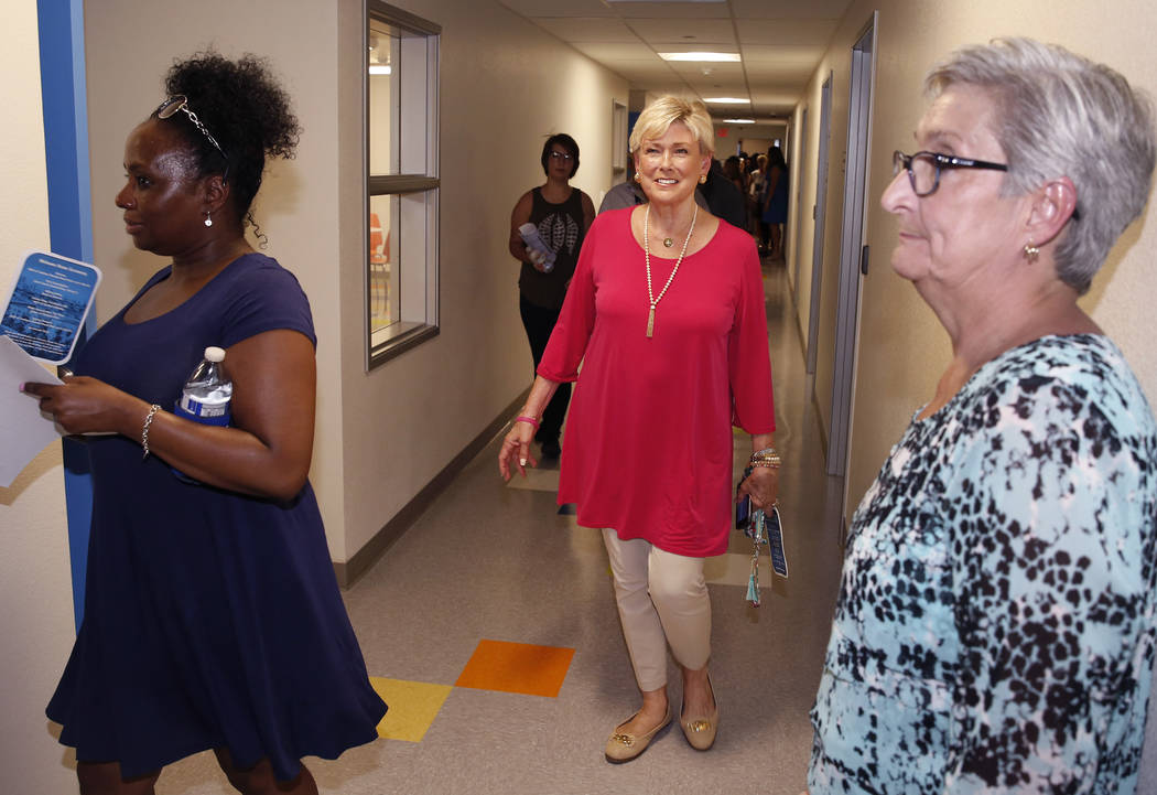 Susan West, center, mother of Shannon West, tours the new Shannon West Homeless Youth Center during the grand opening ceremony of the center on 1650 E. Flamingo Road, on Friday, July 14, 2017, in  ...