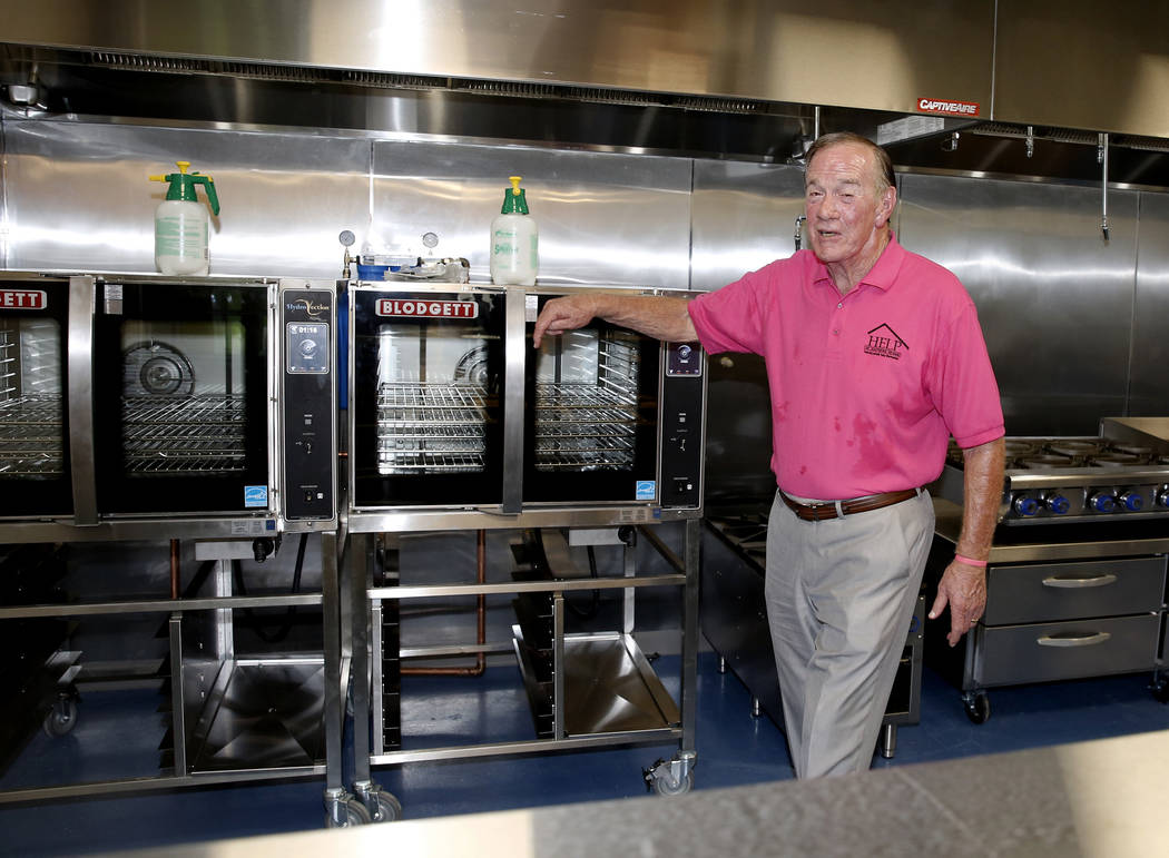 Tom West, left, father of Shannon West, tours the kitchen of the new Shannon West Homeless Youth Center during the grand opening ceremony of the center on 1650 E. Flamingo Road, on Friday, July 14 ...