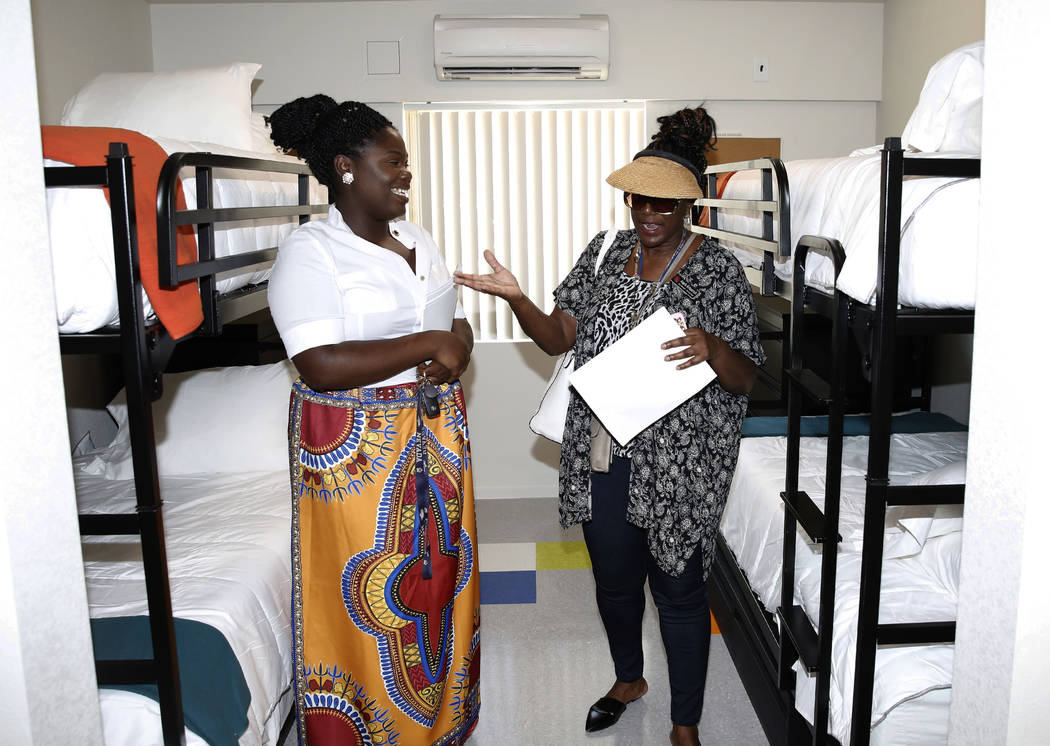 Angela Kirkpatrick, left, speaks to Meshayla Ennis, manager at Shannon West, as she tours the new Shannon West Homeless Youth Center during the grand opening ceremony of the center on 1650 E. Flam ...