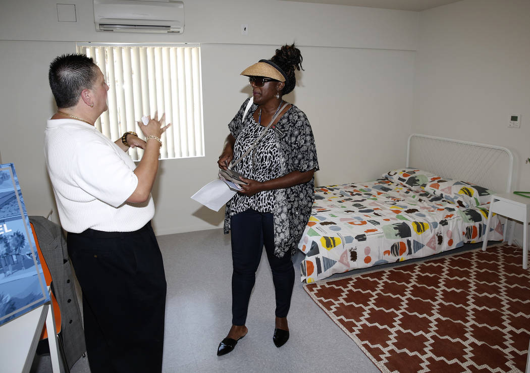 Angela Kirkpatrick, left, listens to Homeless Services Director, Mindy Torres, as she tours the new Shannon West Homeless Youth Center during the grand opening ceremony of the center on 1650 E. Fl ...