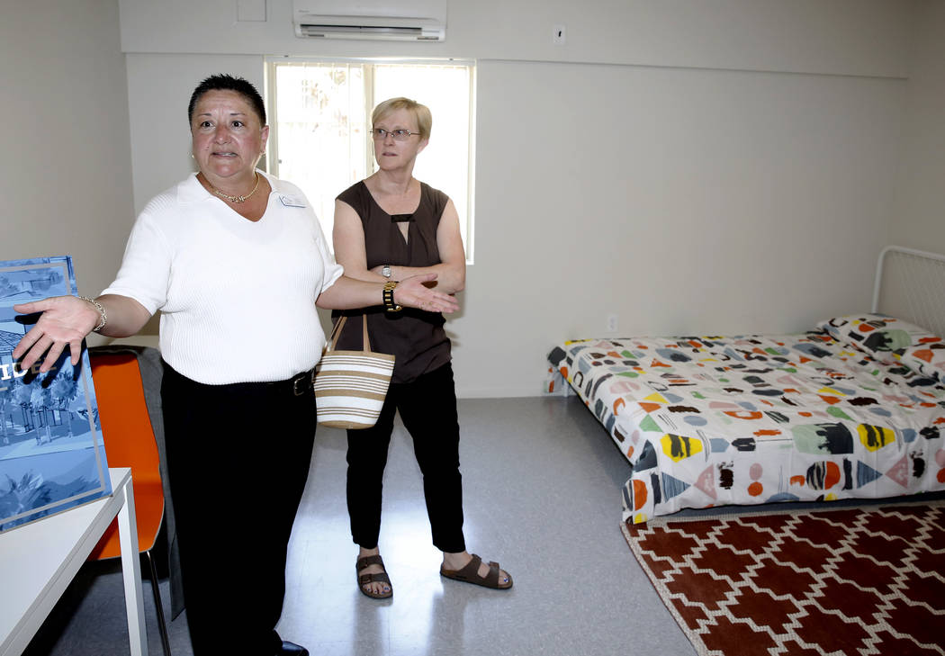 Debbie Levy, right, listens to Homeless Services Director, Mindy Torres, as she tours the new Shannon West Homeless Youth Center during the grand opening ceremony of the center on 1650 E. Flamingo ...
