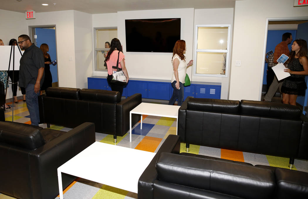 People tour the entertainment and meeting room at the new Shannon West Homeless Youth Center during the grand opening ceremony of the center on 1650 E. Flamingo Road, on Friday, July 14, 2017, in  ...
