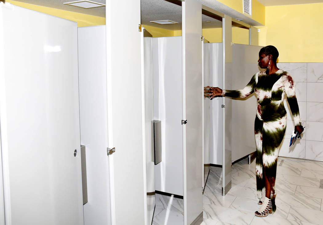 Wendy Ennis tours women's bathroom at the new Shannon West Homeless Youth Center during the grand opening ceremony of the center on 1650 E. Flamingo Road, on Friday, July 14, 2017, in Las Vegas. ( ...