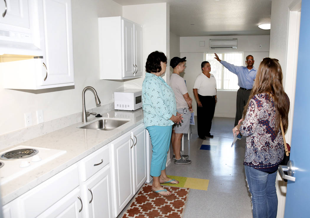 Louis Lacey, second right, program manager for mobile crises intervention team, and Mindy Torres, homeless services director, center, lead a tour of the new Shannon West Homeless Youth Center duri ...
