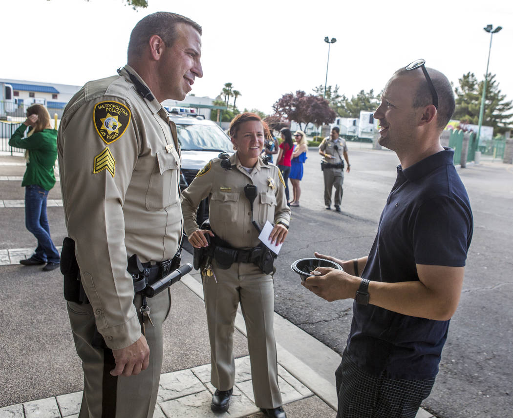 "Sgt. Steve Armbruster and Officer Phalon Mauntel talk with Pavel Stoychev during a ""Chill with a Cop"" event hosted by Metropolitan Police Downtown Area Command at the Anderson Dairy in Las Vegas o ..."