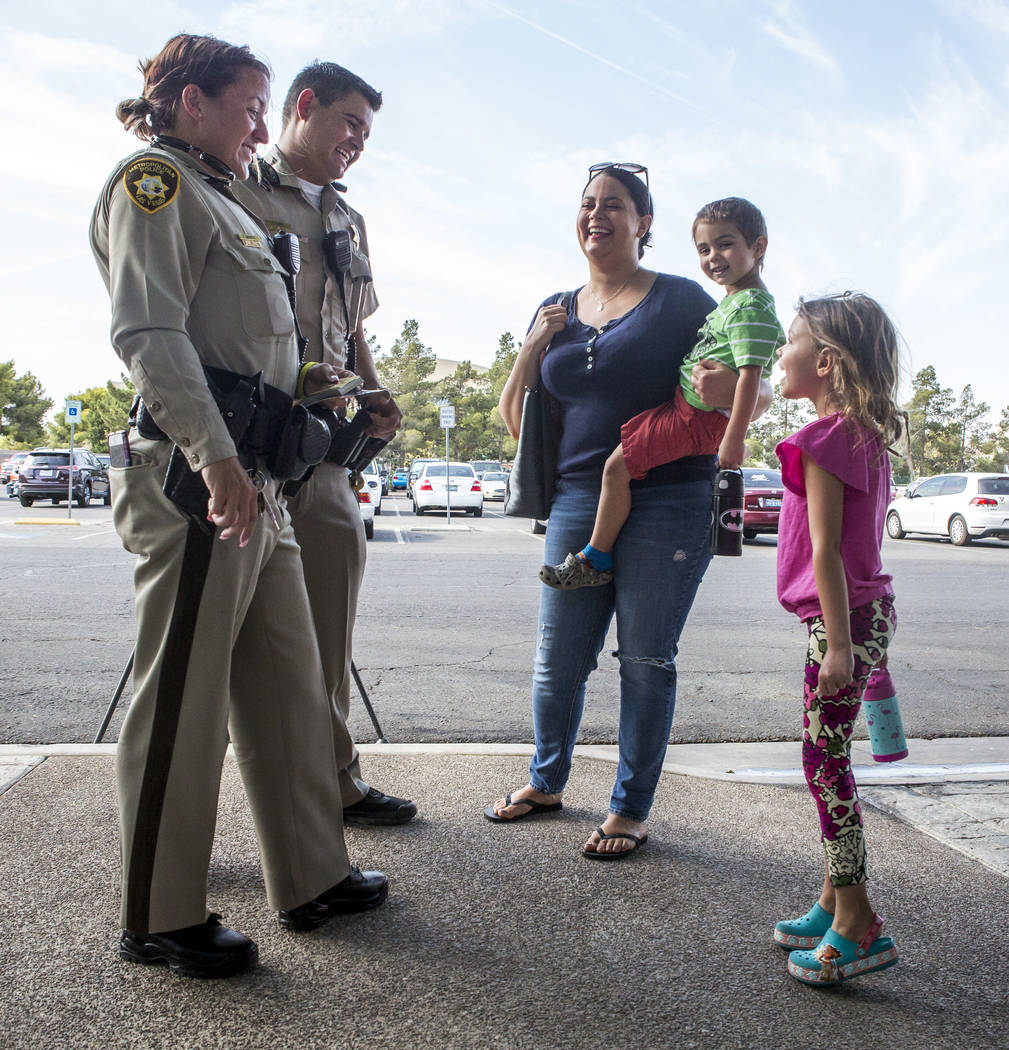 "Officers Phalon Mauntel and Cody Vigil talk with Natalie Gupton and her children Bennett, 3, and Paisley, 5, during a ""Chill with a Cop"" event hosted by Metropolitan Police Downtown Area Command a ..."